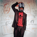 Edo Bertoglio, Jean-Michel Basquiat wearing an American football helmet, 1981, Photo: © Edo Bertoglio, courtesy of Maripol, Artwork: © VG Bild-Kunst Bonn, 2018 & The Estate of Jean-Michel Basquiat, Licensed by Artestar, New York